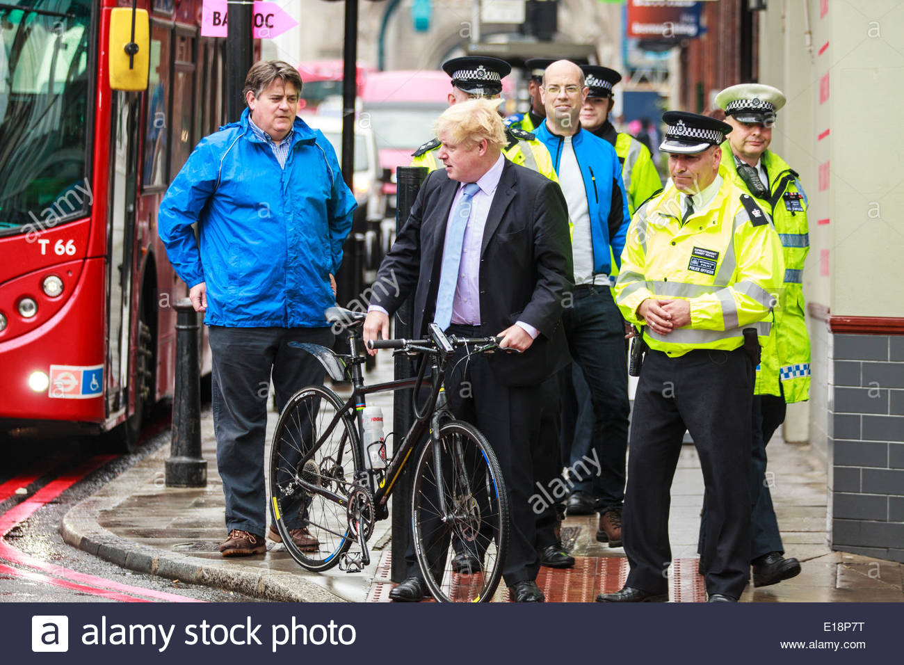 Tower Bridge Road, Bermondsey, London, UK 27th May 2014 Mayor of London Boris Johnson crossing the road with his own bicycle Boris Johnson Road Saftey campaign by the Mayor of London 'Credit: Richard Soans/Alamy Live News' - Stock Image