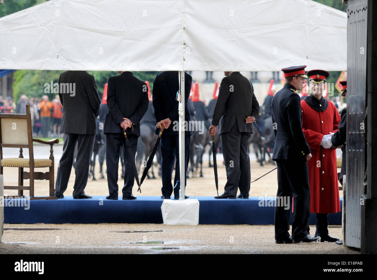 London, 26th May. Rehearsal in the rain for the Presentation of Standards to the Household Cavalry on Wednesday 28th in Horseguards Parade - Stock Image