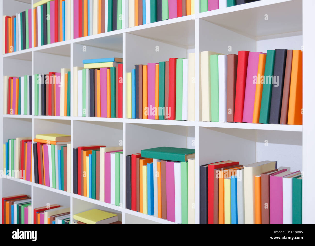 Books on a white shelf, stack of colorful books in Library Stock ...