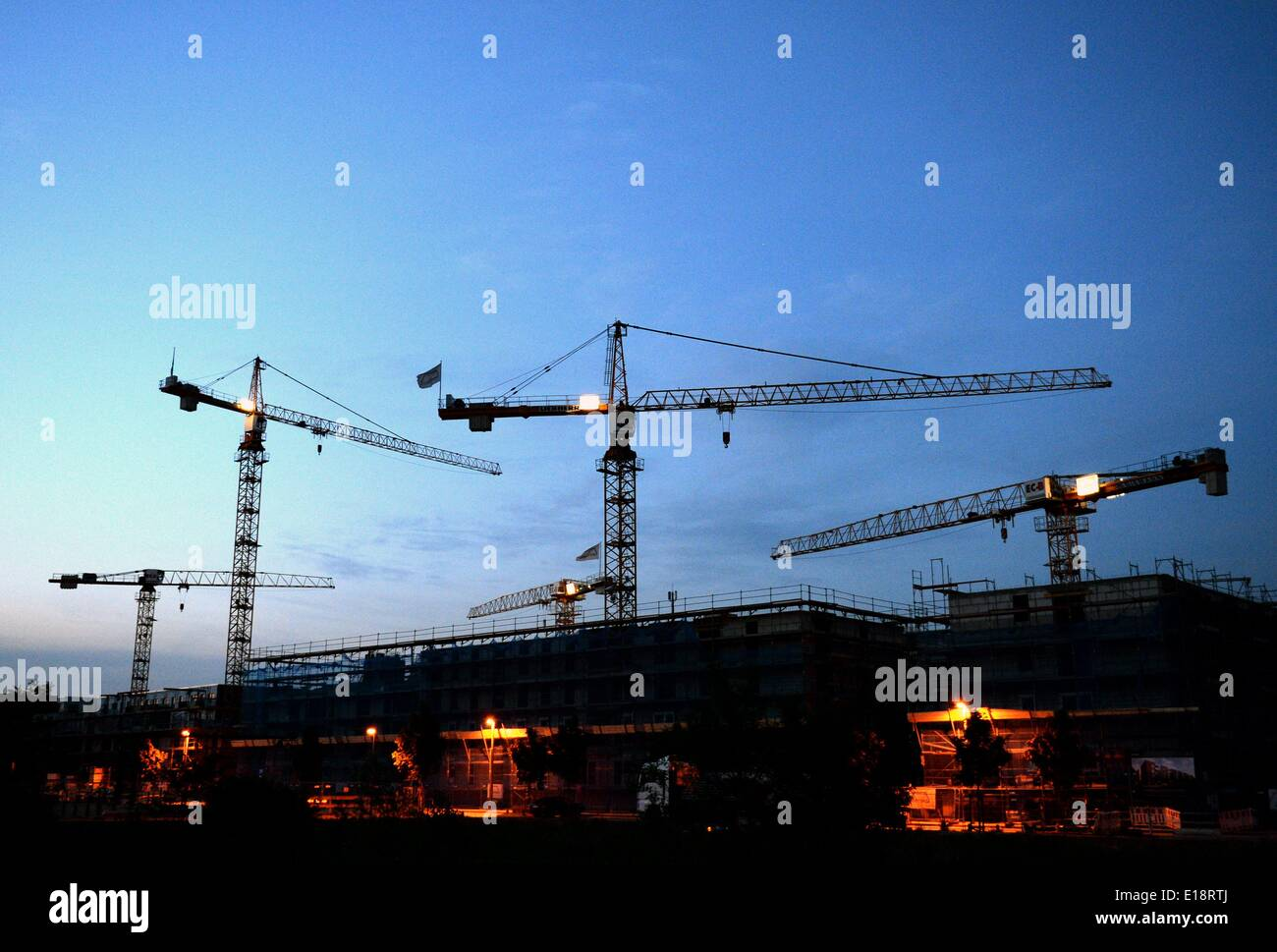 Construction cranes of a building site, captured on 21 May 2014 in Hamburg. Stock Photo