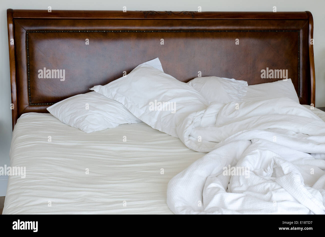 double bed which is unmade and messy stock photo 69650931 alamy