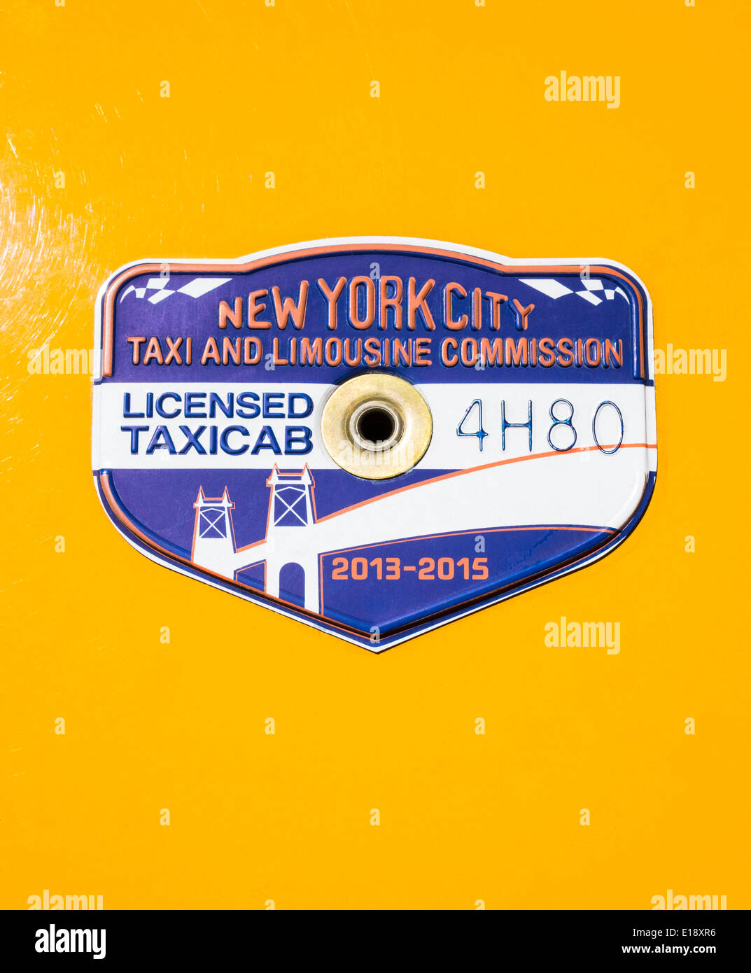 New York City taxicab medallion on yellow cab for 2013-2015 - Stock Image