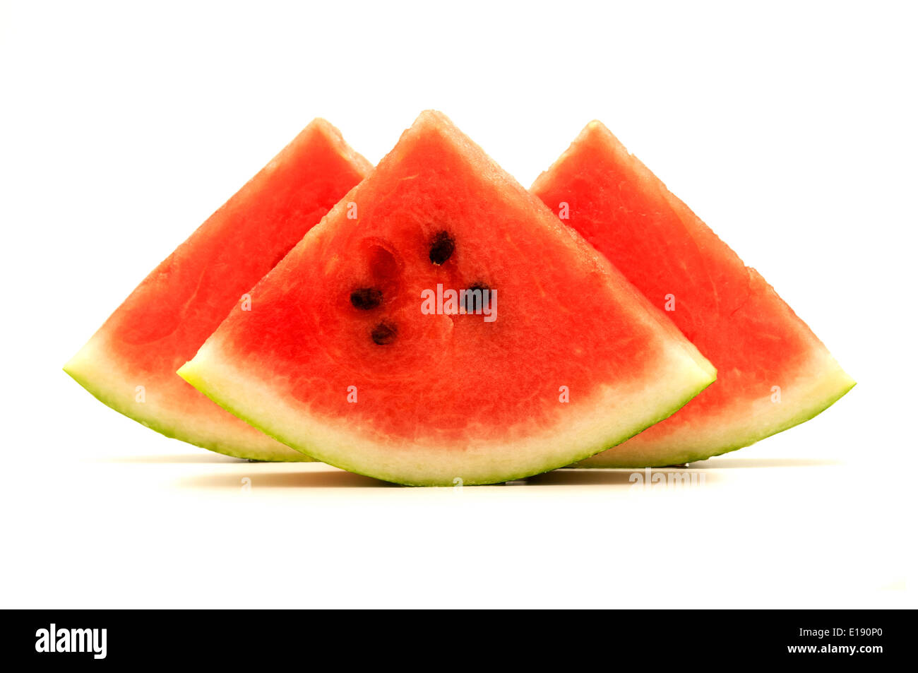 Crimson sweet watermelon wedges on a white background - Stock Image
