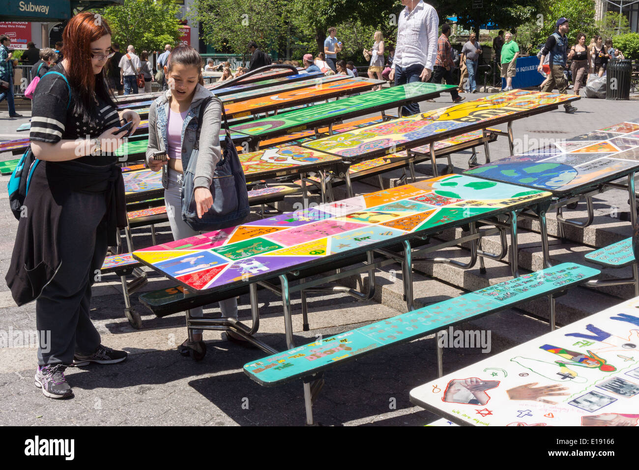 School lunchroom tables decorated with art representing various social issues are seen in Union Square Park in New York - Stock Image