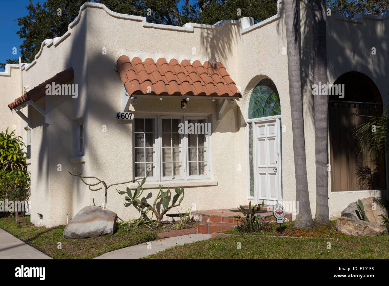 1930's Style Florida Bungalow and Tropical Landscaping, Residential Neighborhood Tampa, FL, USA - Stock Image