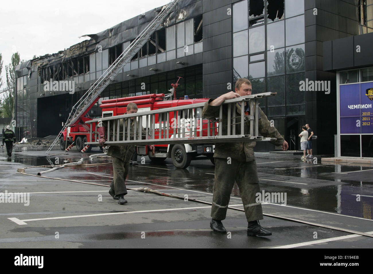 Donetsk, Ukraine. 27th May, 2014. Firefighters work at the burnt Druzhba Hockey Arena in Donetsk, Ukraine, May 27, 2014. Home arena of Donetsk hockey club 'Donbas' was burned at Monday night by unknown armed people. Credit:  Alexander Ermochenko/Xinhua/Alamy Live News - Stock Image
