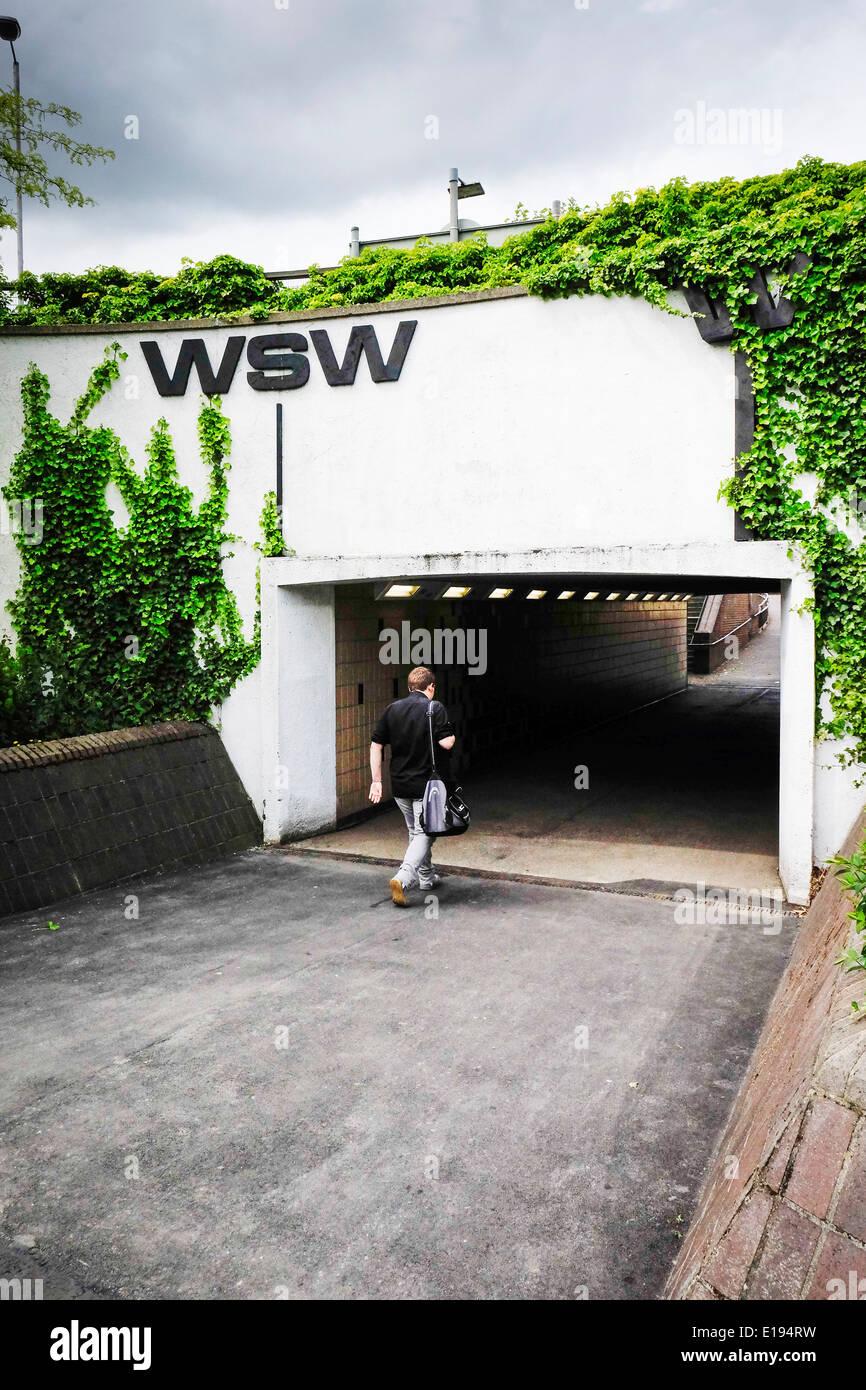 A pedestrian walking through an underpass. - Stock Image