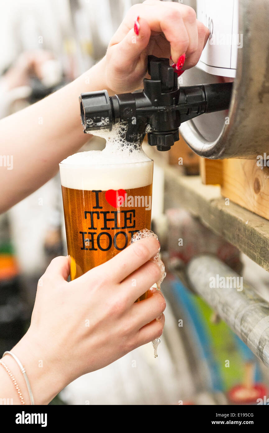 A pint of real ale being poured. - Stock Image