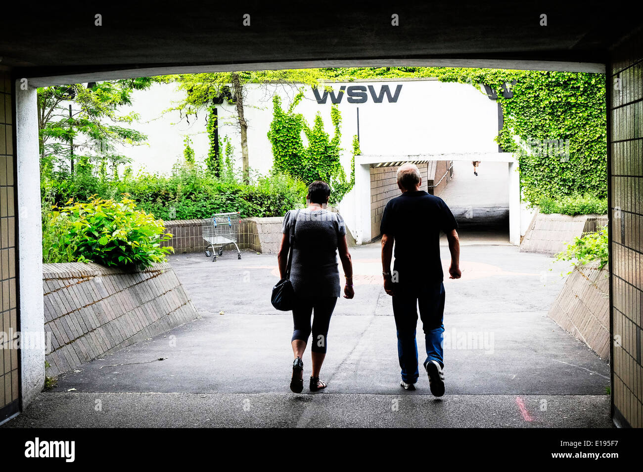People walking through pedestrian underpasses in Basildon Stock Photo