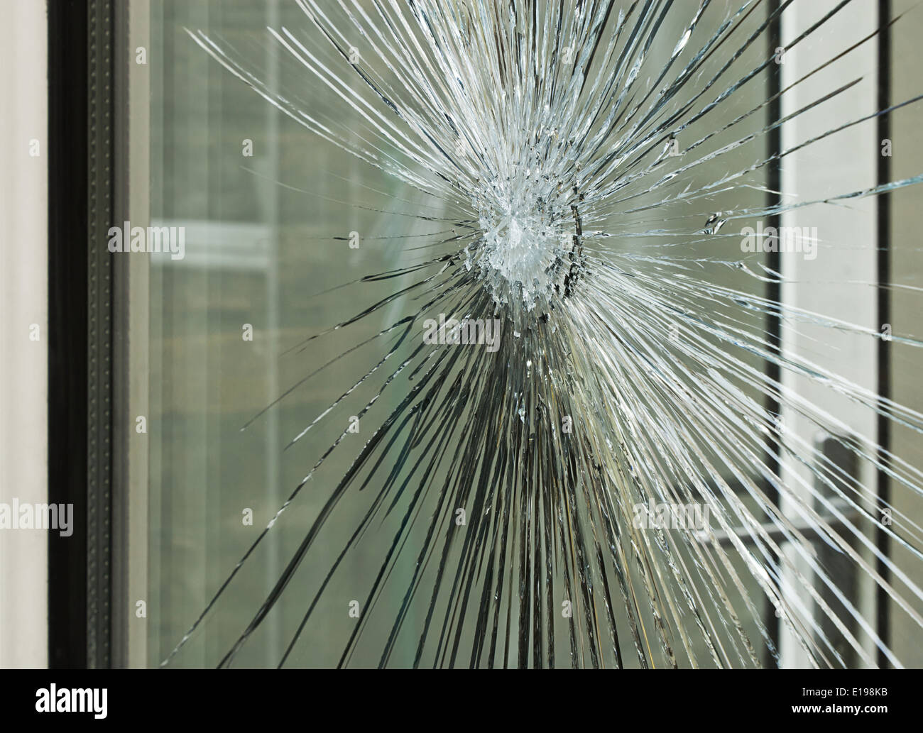 Broken glass window smashed by accident or after a break in, great for an insurance claim. - Stock Image