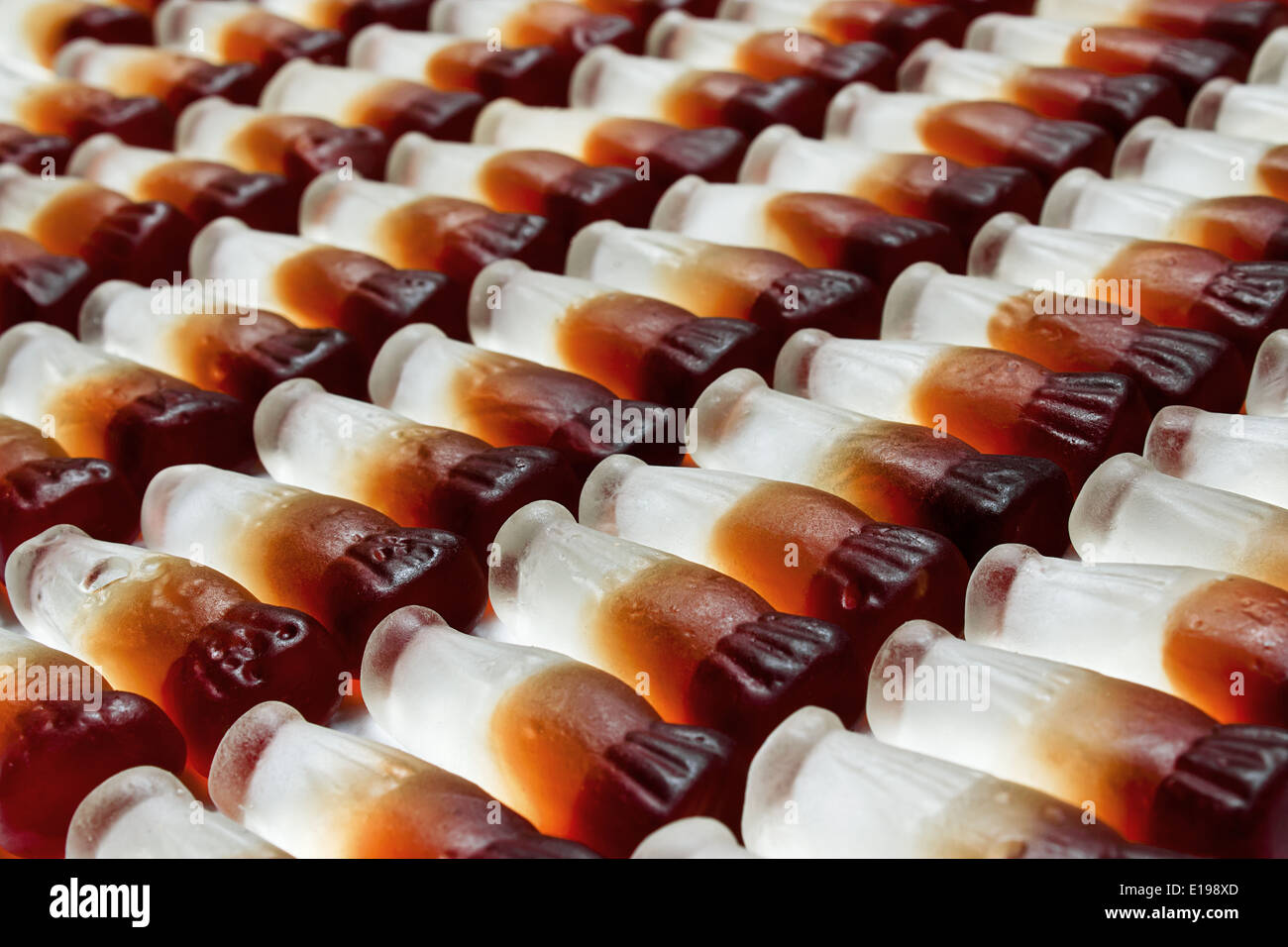 Cola bottle background arranged in rows - Stock Image