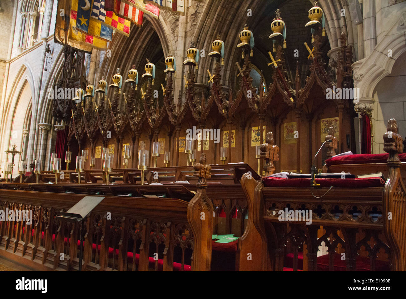 Choir stalls with the banners and hatchments of the Knights of Saint Patrick Saint Patrick's Cathedral Dublin,Ireland - Stock Image
