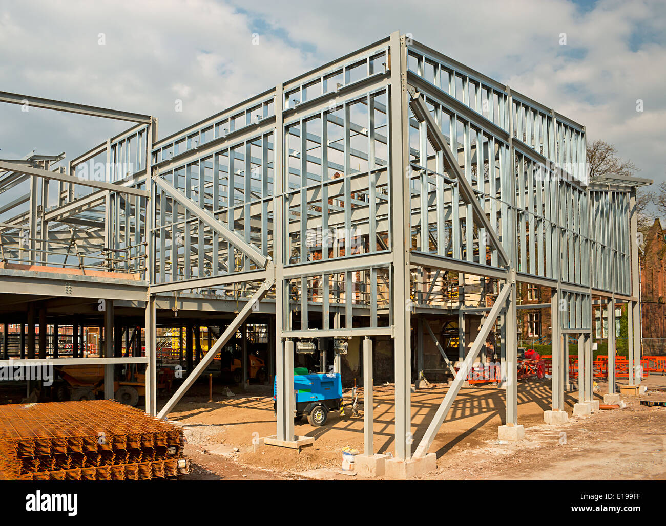 Steel framed building at a construction site ready for cladding with columns. A new commercial office complex. - Stock Image