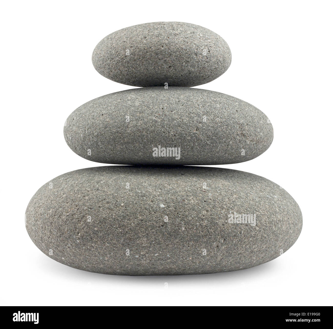 Rounded pebbles balancing in a uniform stack great concept for the perfect life balance - Stock Image