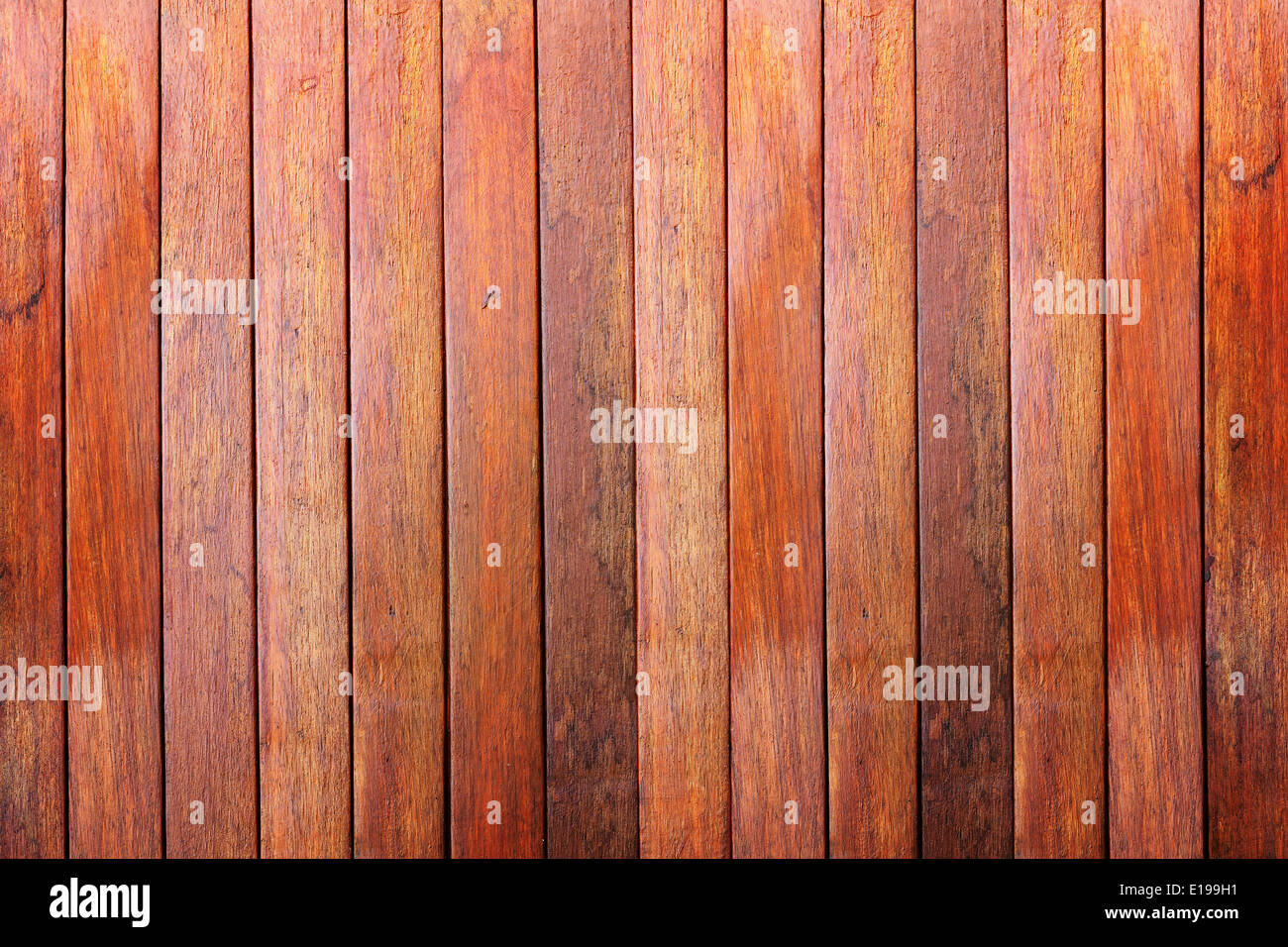 Wooden wall background made with vertical planks of hardwood - Stock Image
