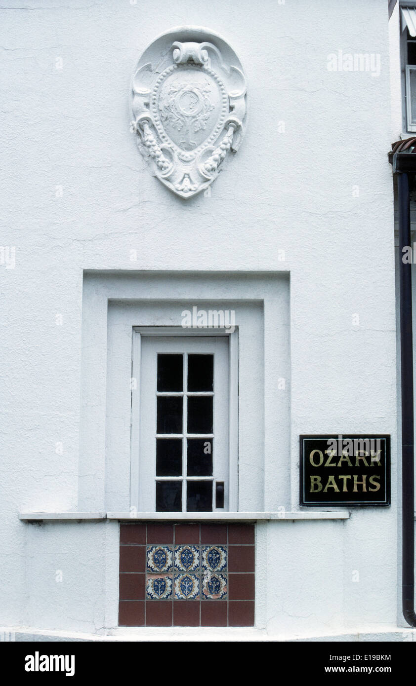 An ornamental cartouche is above a former entry door to the old 1922 Ozark Baths on historic Bathhouse Row in Hot Stock Photo
