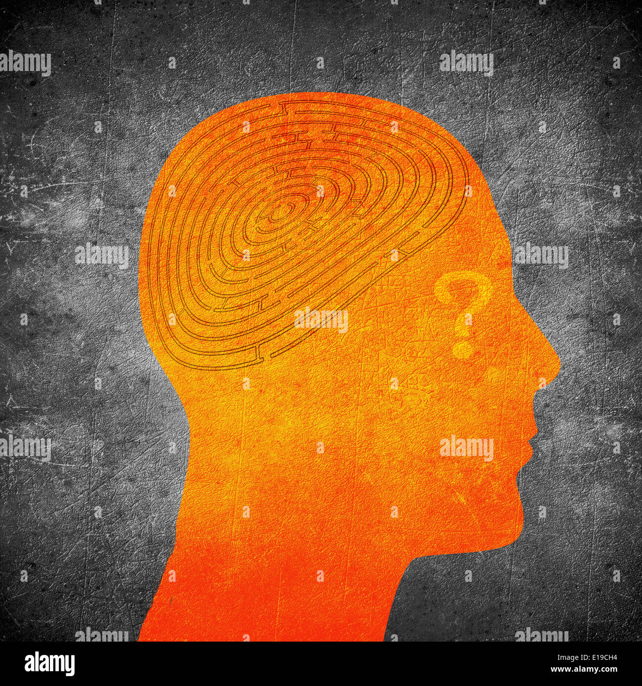 orange human head with labyrinth brain - Stock Image
