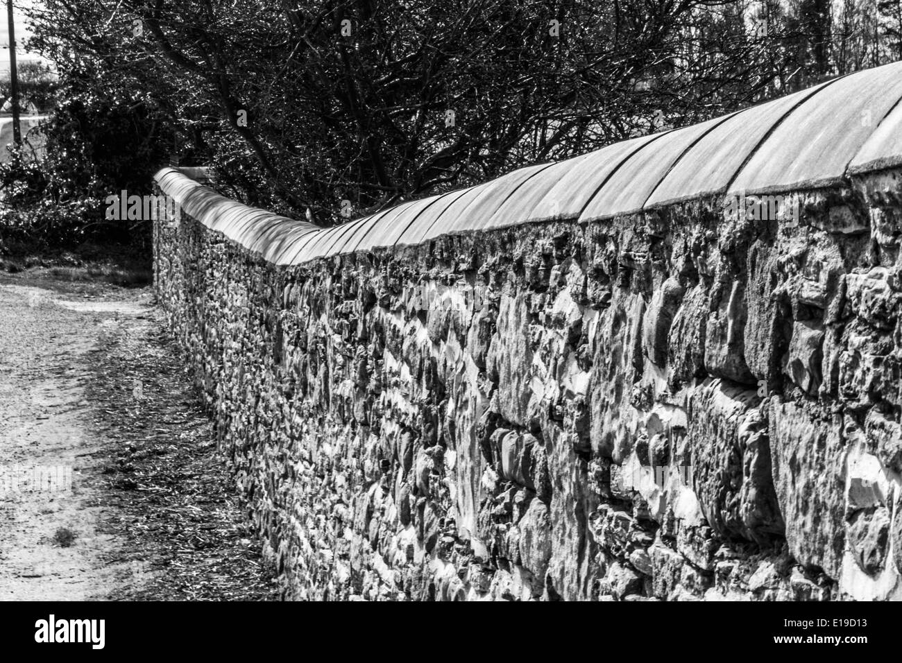 Black and White photo of a church boundary wall - Stock Image