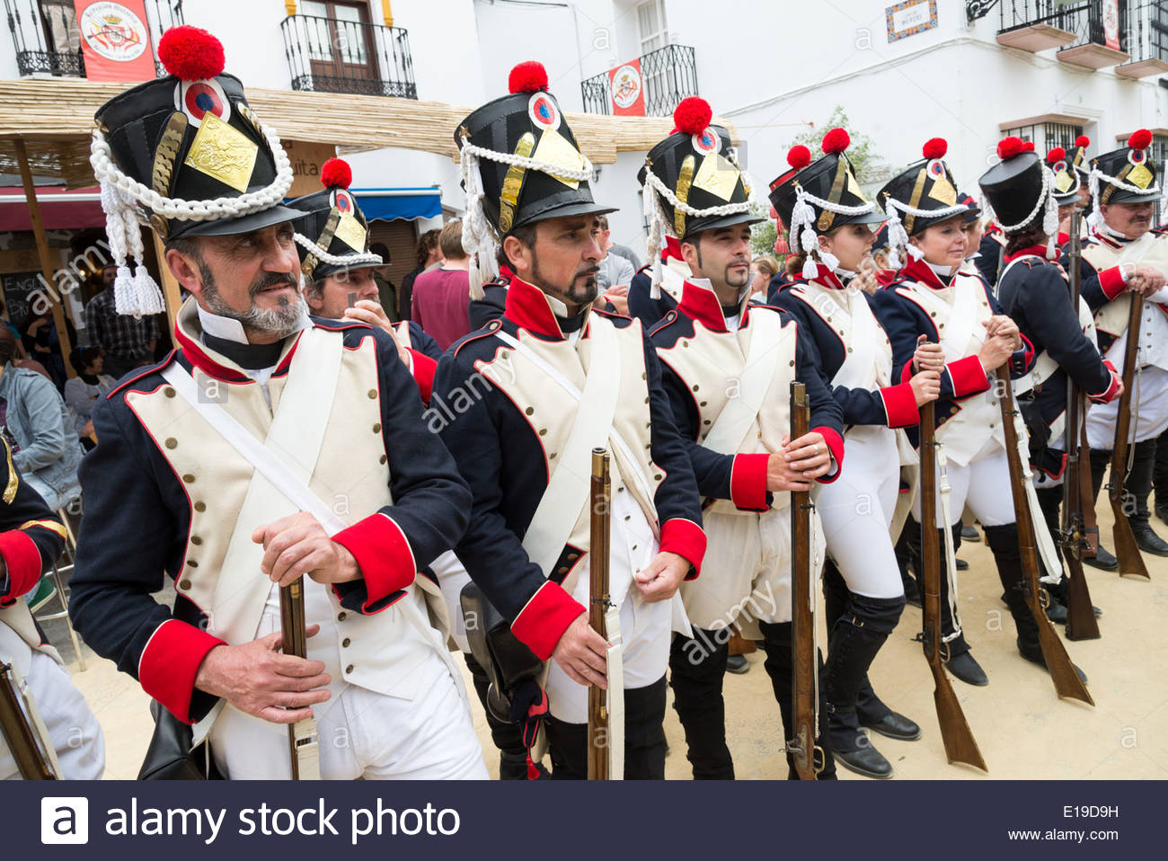 Men dressed as Napoleonic troops for the annual re-enactment of the 2 May 1810 French invasion of Algodonales, Andalucia, Spain - Stock Image