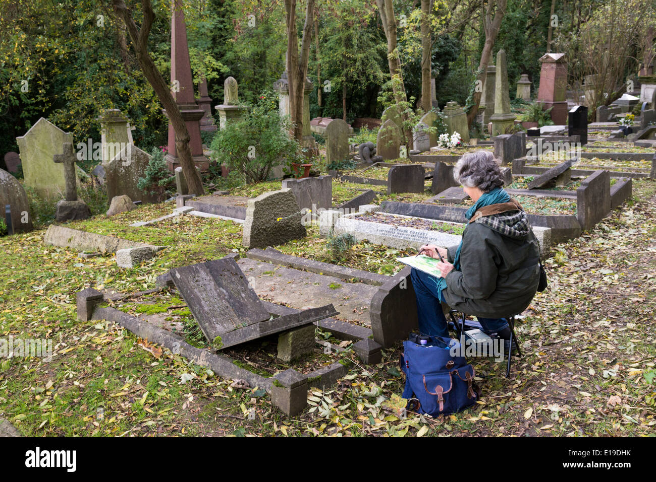 Artist painting in Highgate Cemetery, London, England, UK Stock Photo