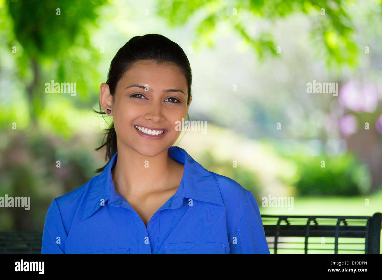 Smiling woman in park - Stock Image