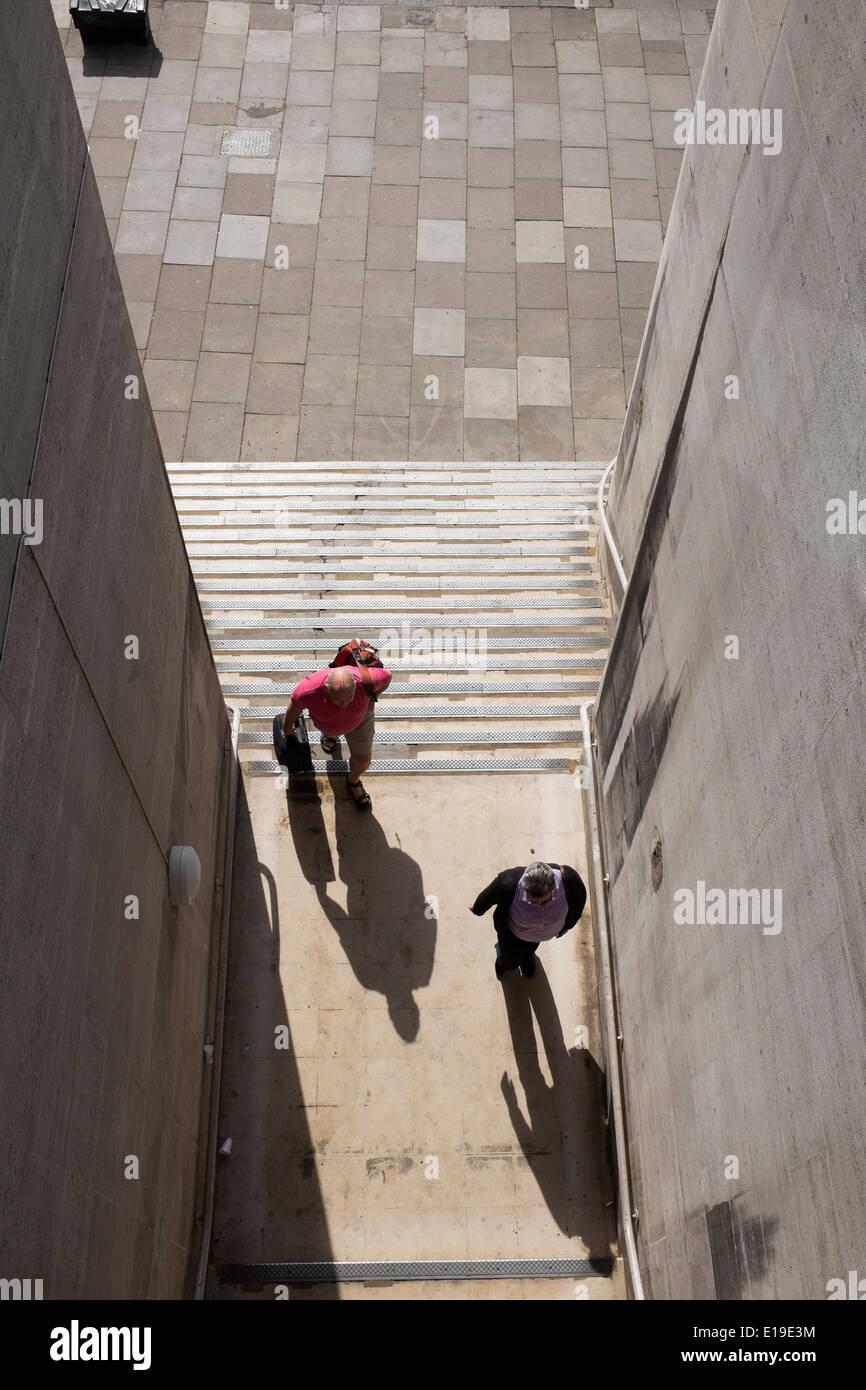 couple climbing steps under waterloo bridge stock photo 69664776