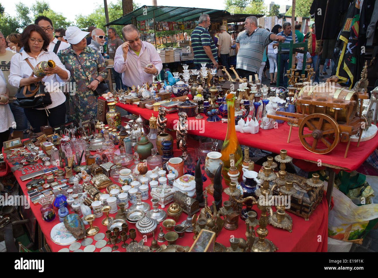 Bargain hunters at the El Rastro Flea Market in Madrid Stock Photo