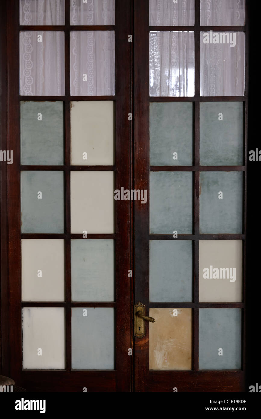 screen door in traditional old house in the barrio paris londres Santiago Chile - Stock Image