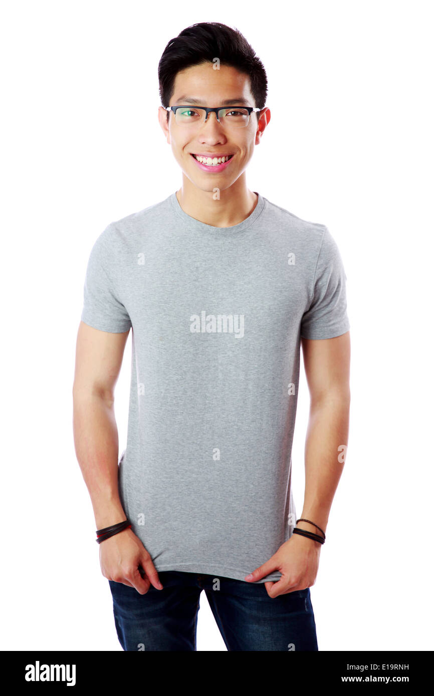 Young smiling asian man standing over white background - Stock Image