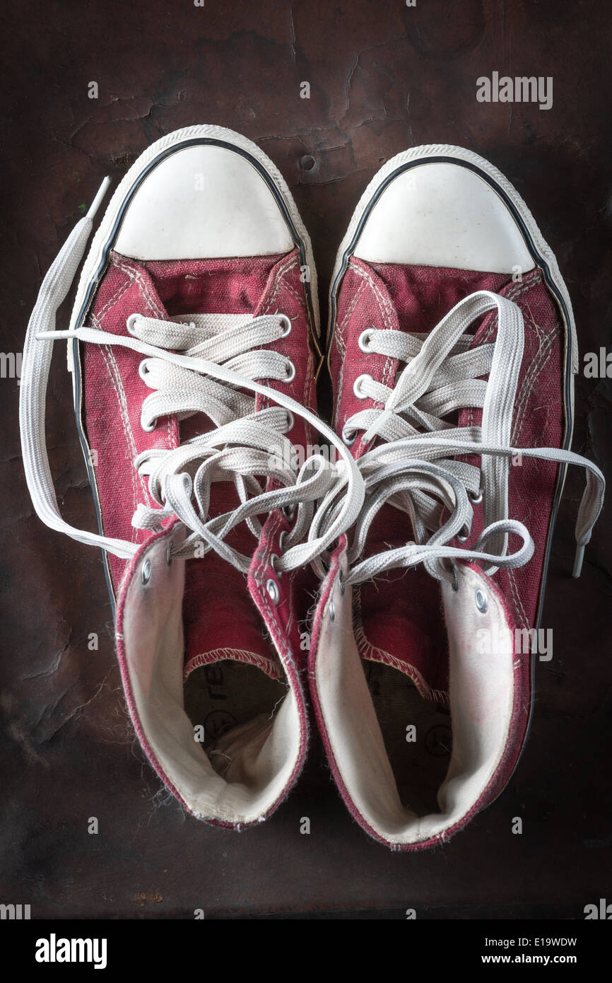 old red Sneakers on old Leather - Stock Image