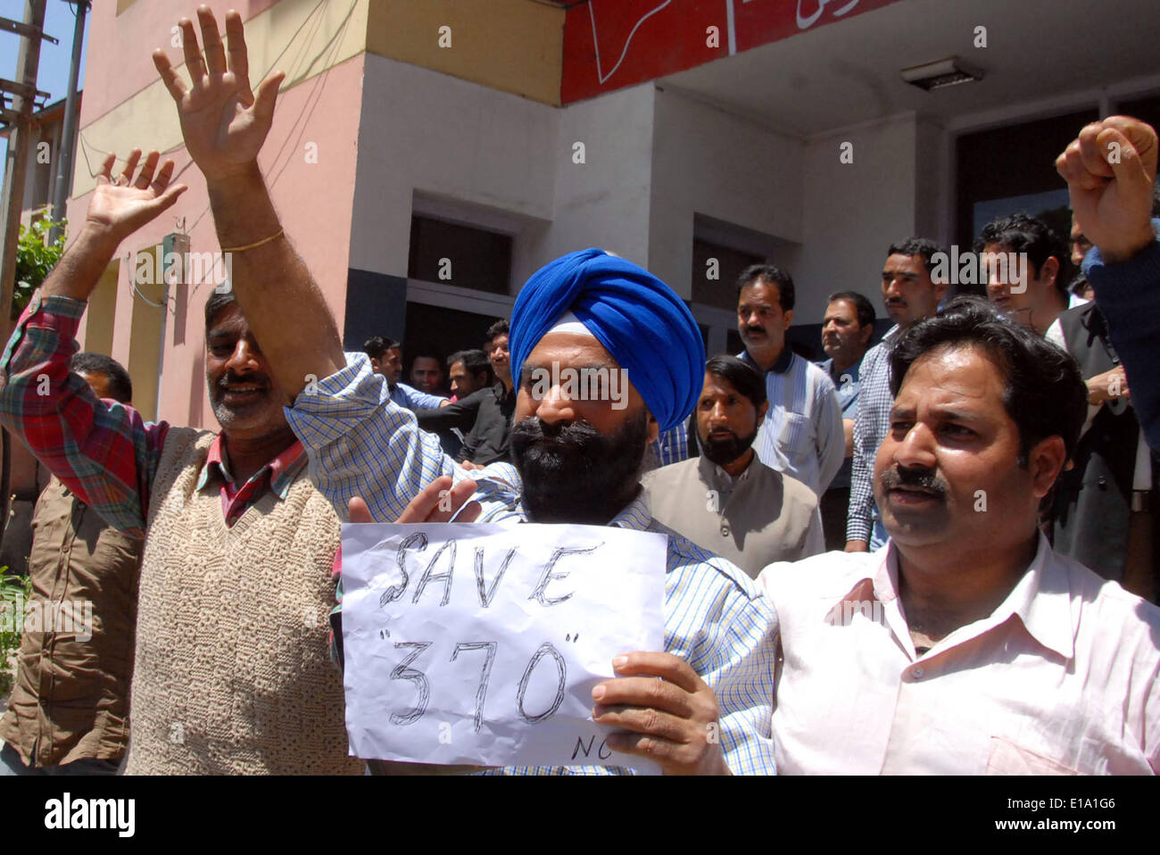 Srinagar, Indian Administered Kashmir. 28 May 2014 :National Conference (NC) workers and leaders shout slogans outside Stock Photo