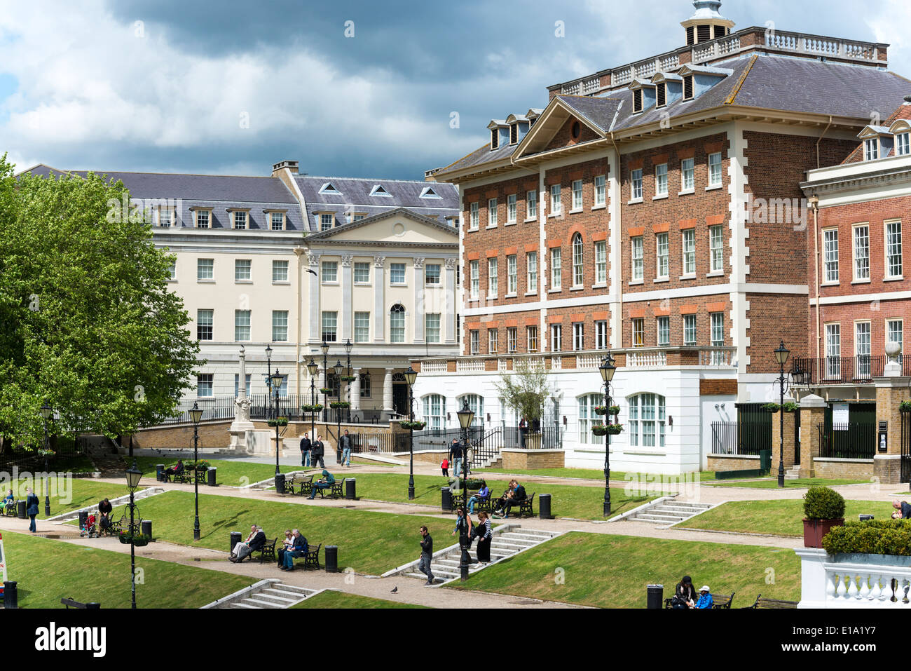 The embankment at Richmond upon Thames London UK. A view showing people sitting on benches and the grand buildings on the rivers - Stock Image