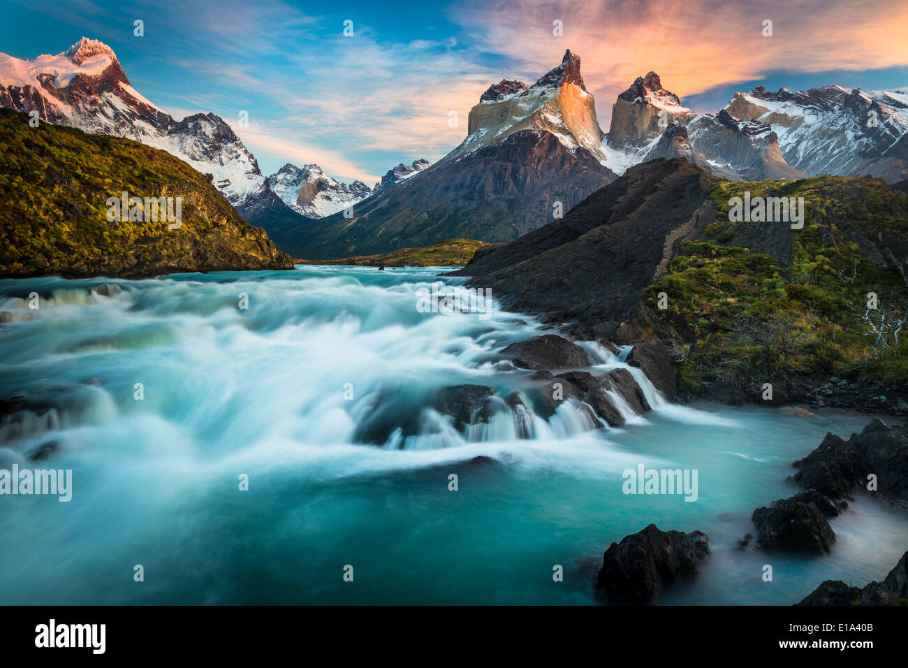 Los Cuernos towering above Salto Grande and Lago Nordenskjold, Torres del Paine, Chilean Patagonia. - Stock Image