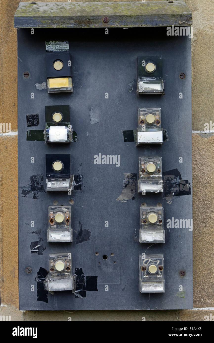 Doorbell Buzzers On An Old Door Entry System Uk Stock Photo