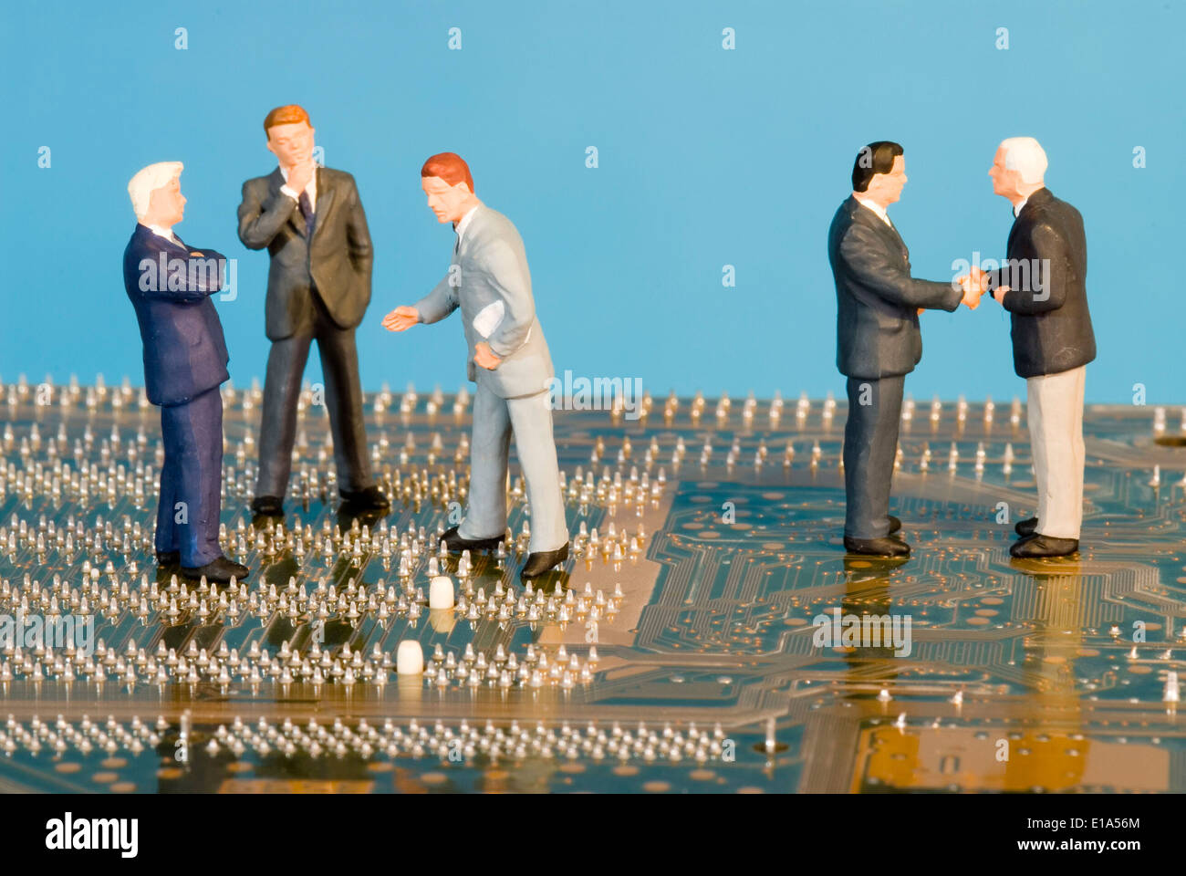 Concept image showing businessmen on a computer chip - Stock Image