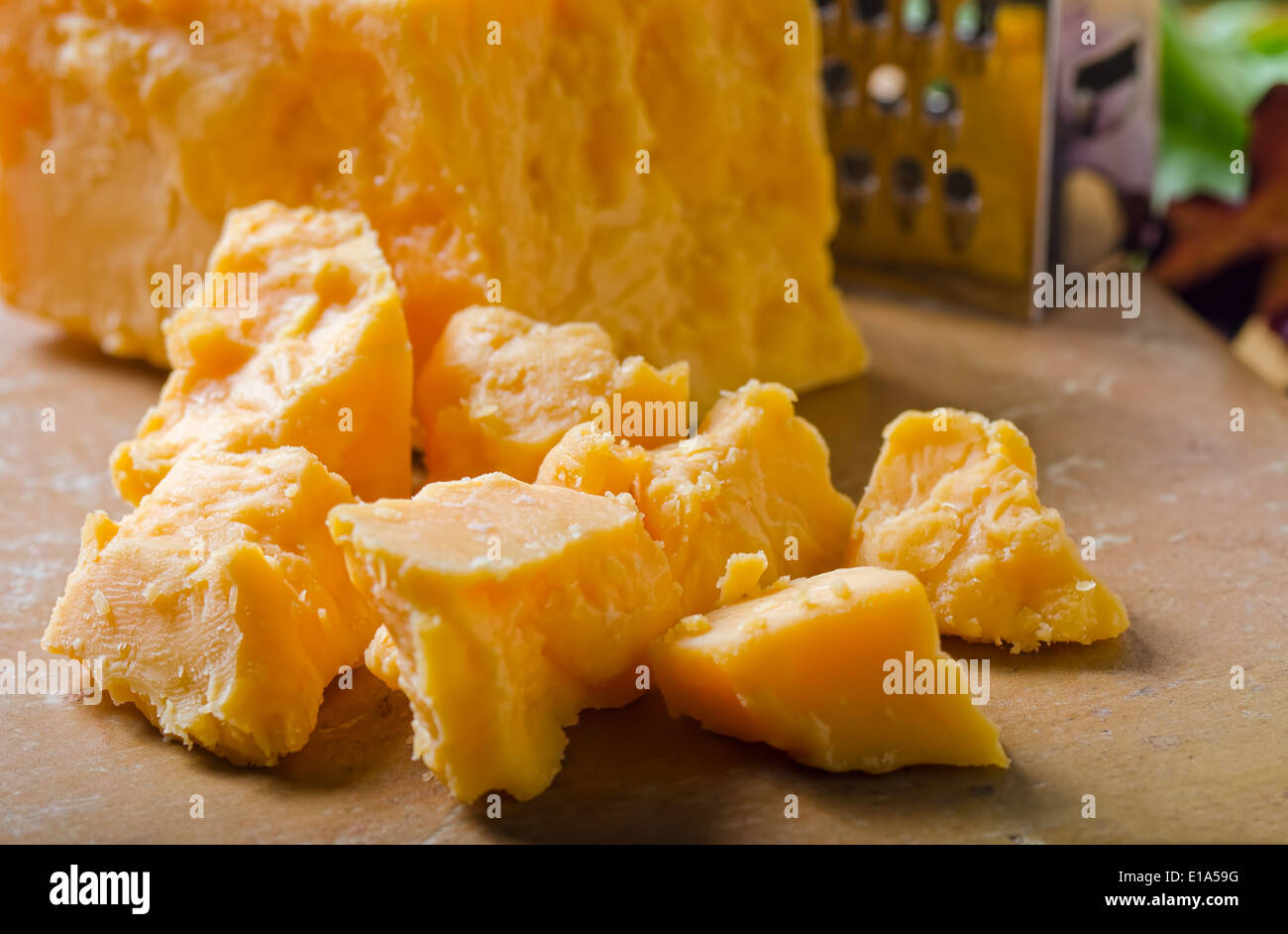 A grouping of crumbled cheddar cheese. - Stock Image