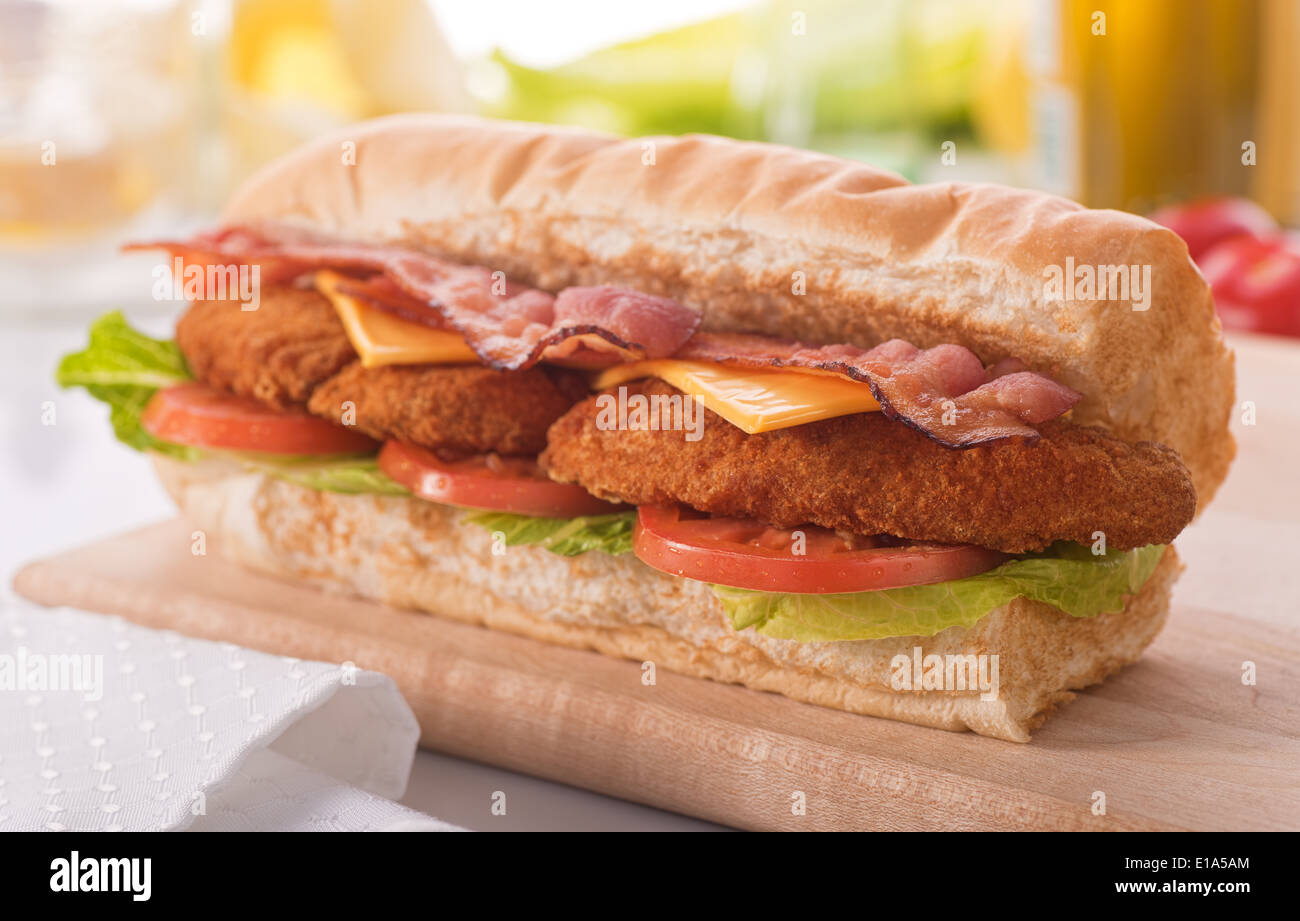 A delicious crispy chicken clubhouse submarine sandwich. - Stock Image