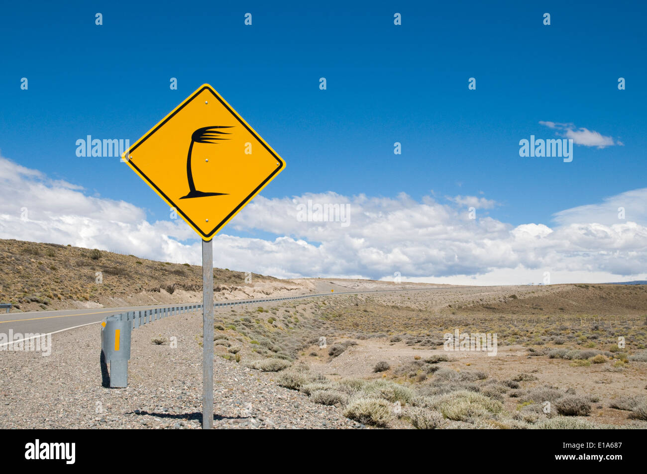 traffic road sign on the Ruta Nacional 40, heavy side wind, Santa Cruz, Patagonia, Argentina - Stock Image
