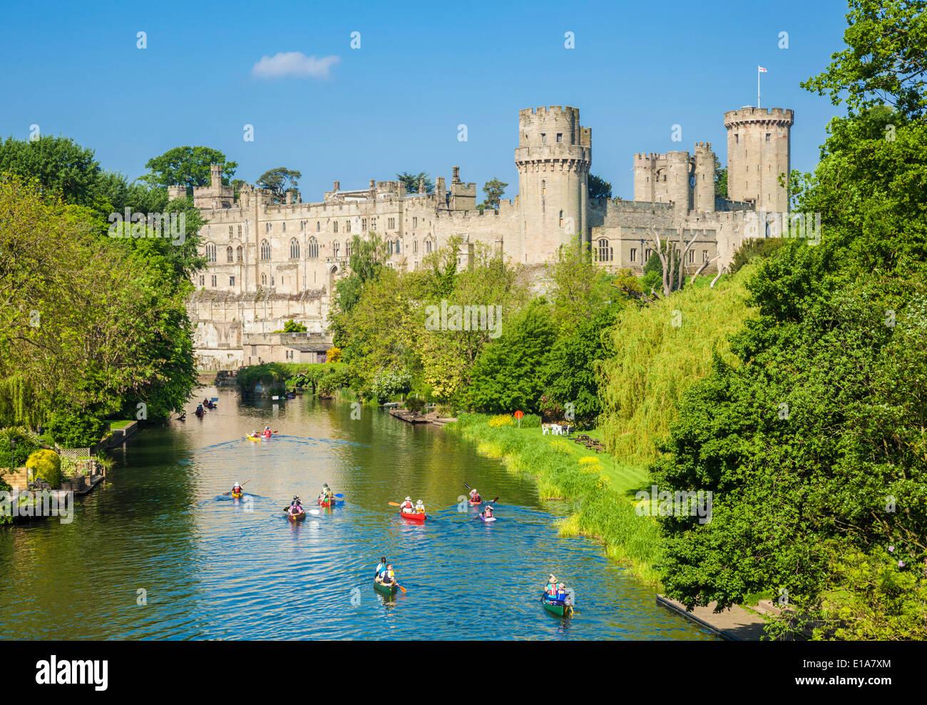 Tourist canoes, Warwick Castle and River Avon Warwick Warwickshire, England UK GB EU Europe - Stock Image