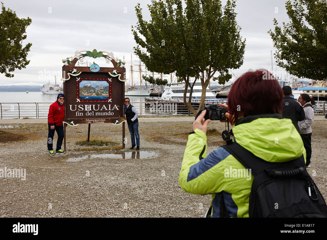 tourists taking photos at Ushuaia fin del mundo end of the world sign Argentina - Stock Image