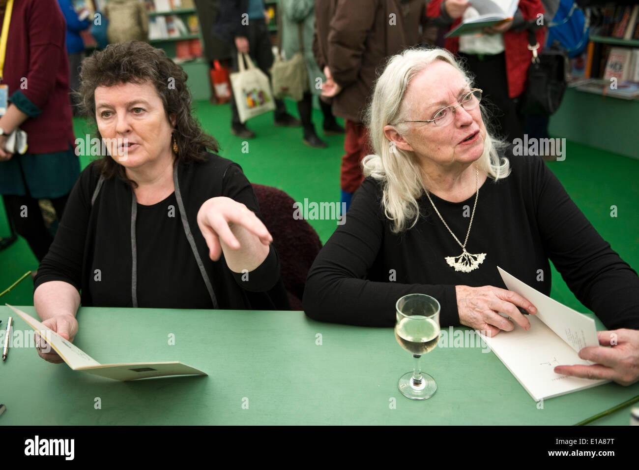 Poets Carol Ann Duffy & Gillian Clarke book signing at Hay Festival 2014. Hay on Wye Powys Wales UK  ©Jeff Morgan - Stock Image