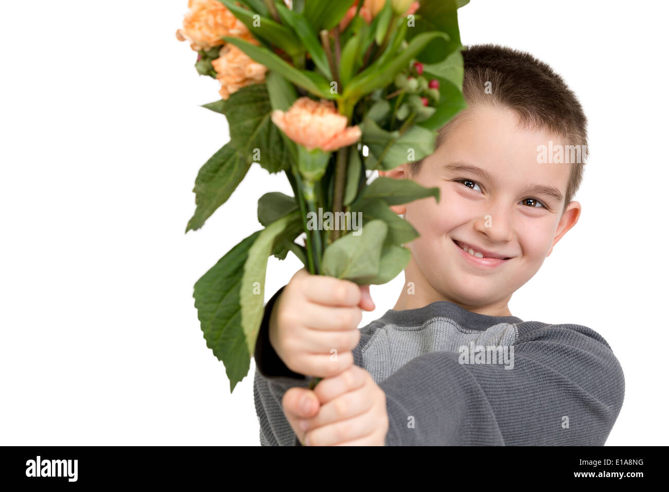 Eight Years Old Boy Presenting Flowers Perhaps He Is Trying To Say