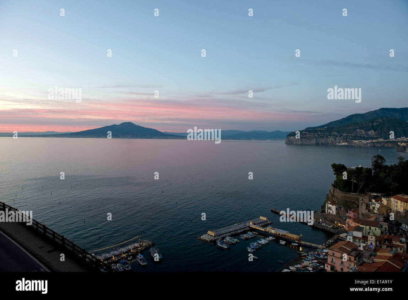Red sky behind Mount Vesuvius, an active volcano, viewed across the Bay of Naples from Sorrento at sunset - Stock Image