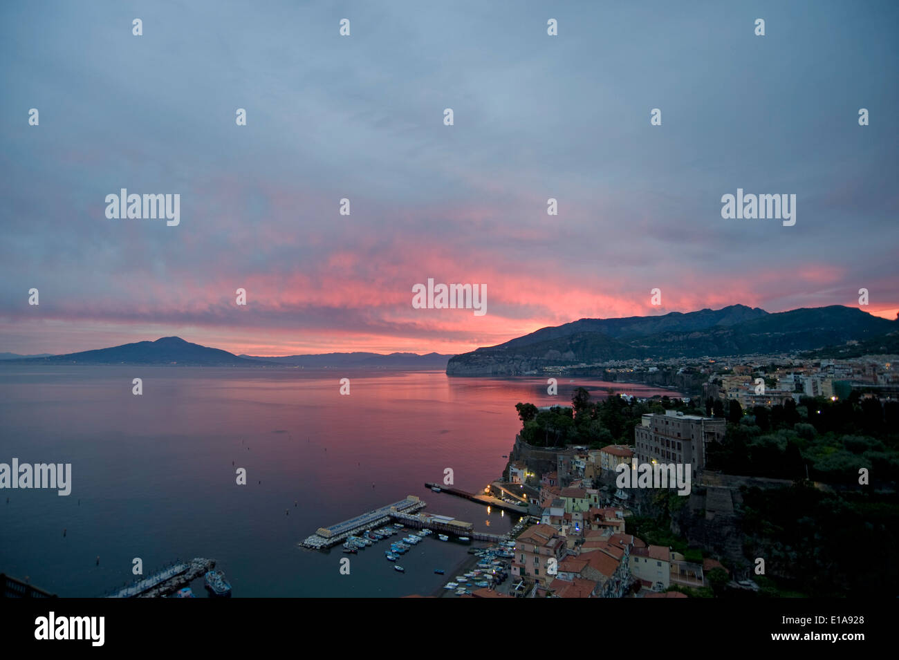 A fiery sunrise with red sky over Sorrento, the Bay of Naples and Mount Vesuvius, an active volcano, Italy - Stock Image