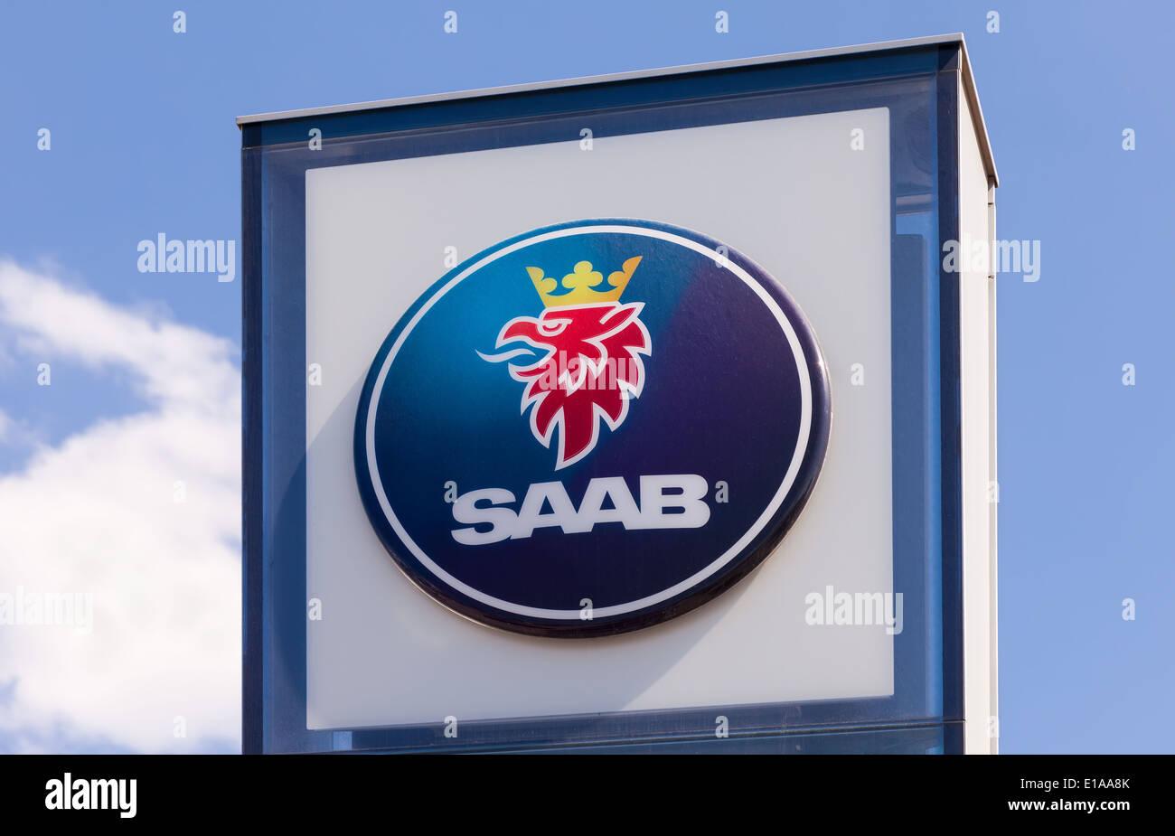 The emblem SAAB dealer car automaker brand trade sky motor over blue sky - Stock Image