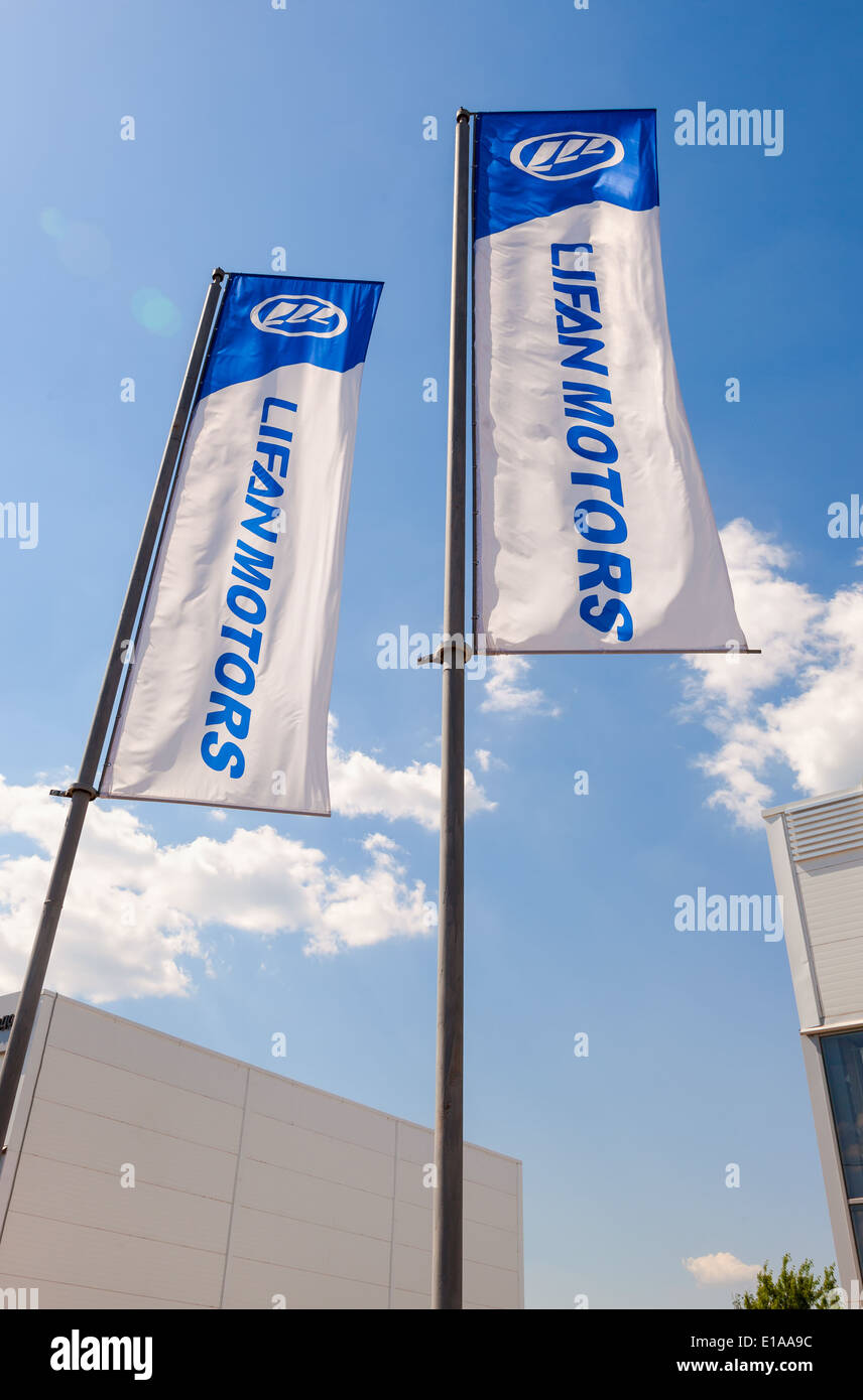 The flags of Lifan Motors over blue sky - Stock Image