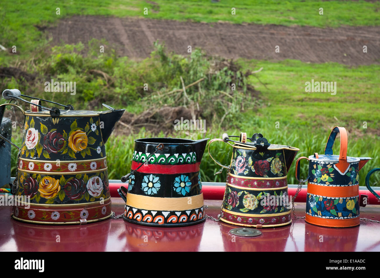 painted jugs decorate a narrowboat moored on the Staffordshire and Worcestershire Canal in the Black Country, England - Stock Image