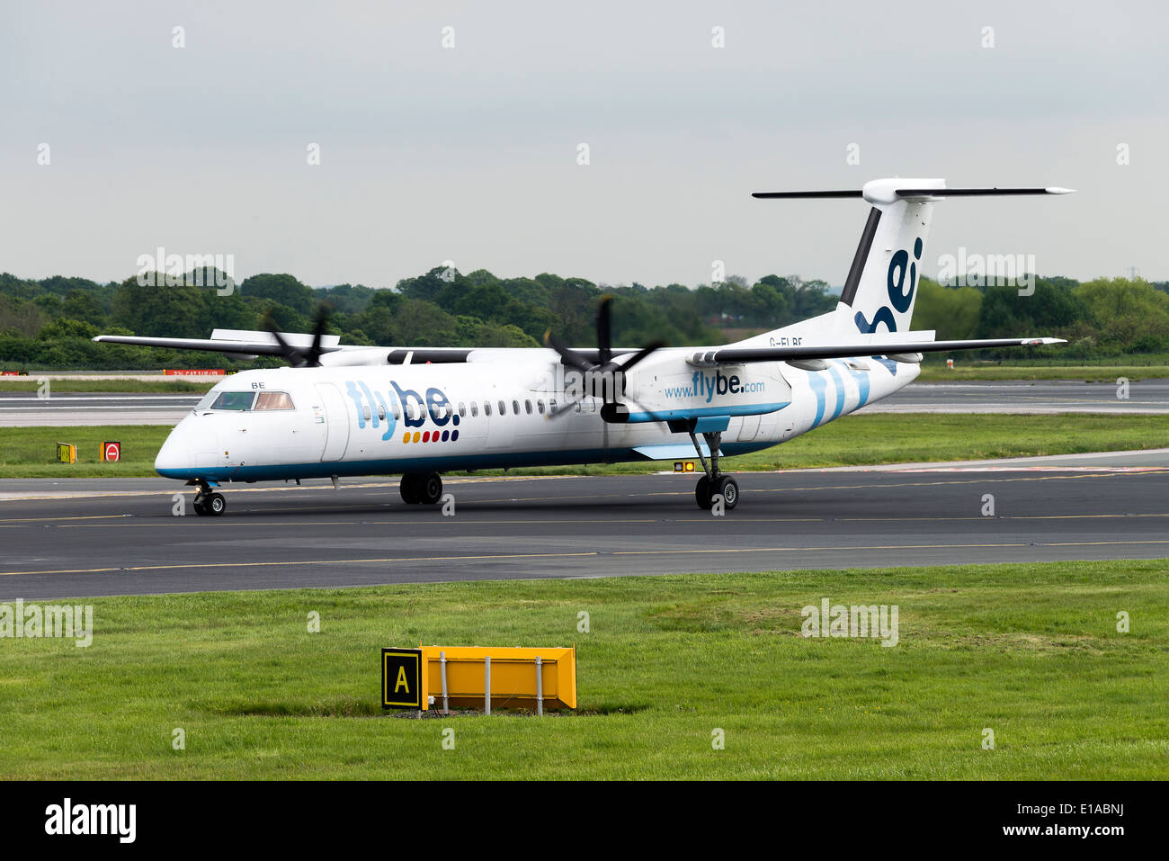 Flybe Bombardier DeHavilland Canada DHC-8-402Q Dash8 Airliner G-FLBE Taxiing at Manchester Airport England United Kingdom UK - Stock Image
