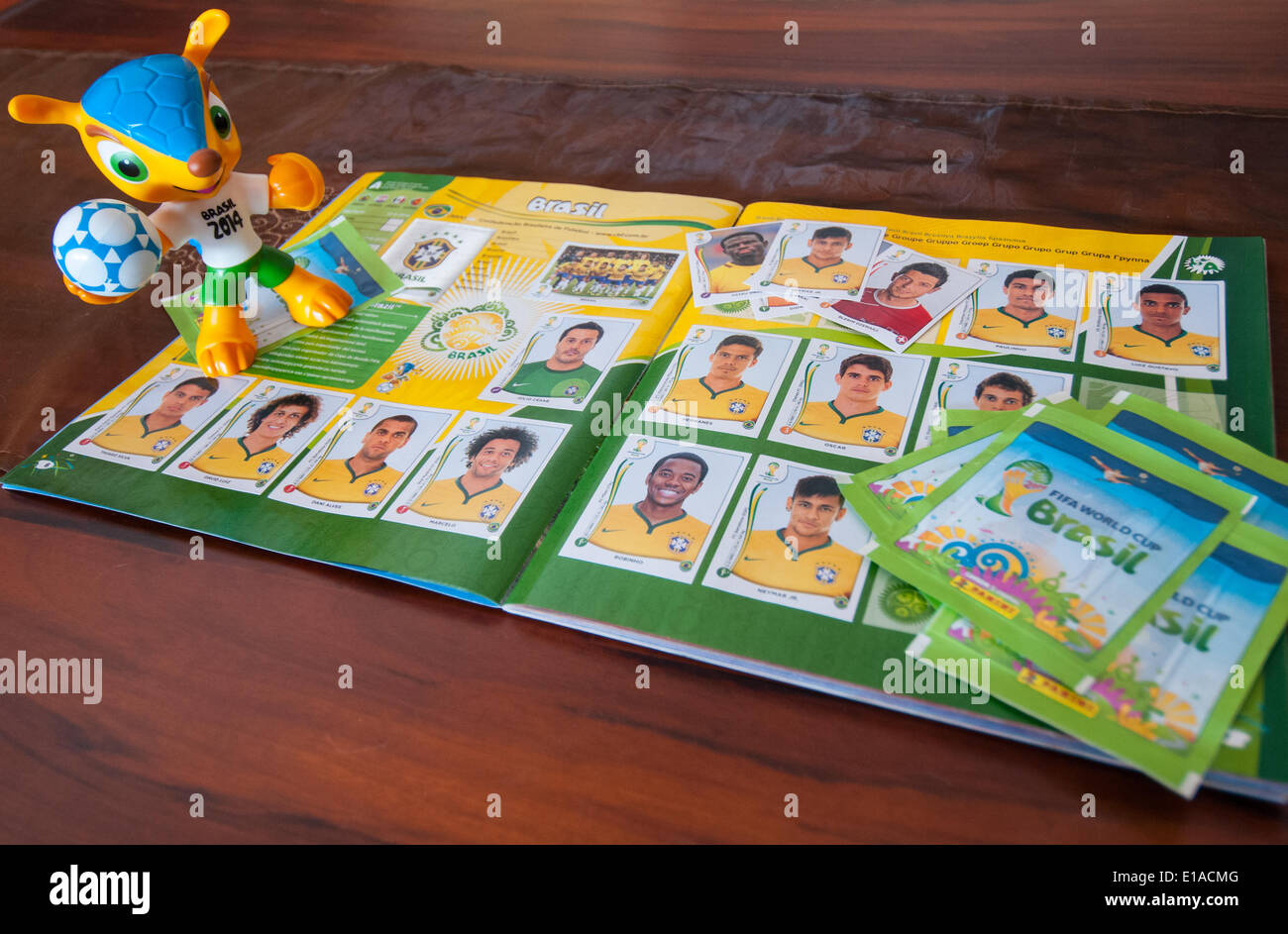 Collector cards and the Mascot of the World Cup 2014 in Brasilia Brazil, in anticipation of the June 2014 soccer games - Stock Image