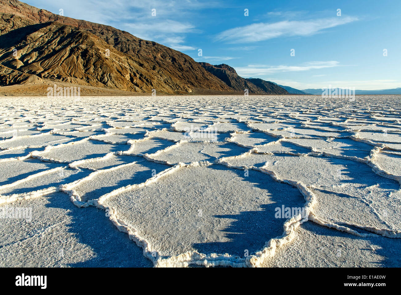 Polygonal salt pans and Black Range, Badwater Basin, Death Valley National Park, California USA - Stock Image